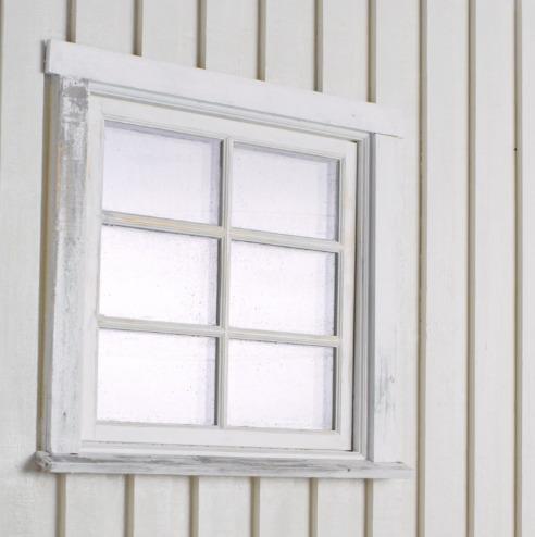 Et utendørs bilde av et tidligere malt vindu